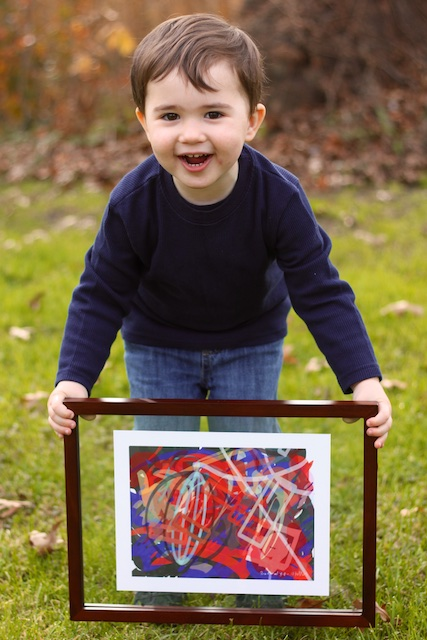 Jonah Holding His Art